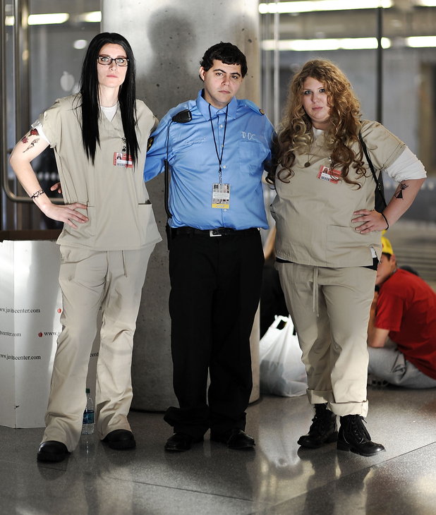 NEW YORK, NY - OCTOBER 12: Comic Con attendees pose as characters from Orange is the New Black during the 2014 New York Comic Con at Jacob Javitz Center on October 12, 2014 in New York City. (Photo by Daniel Zuchnik/Getty Images)