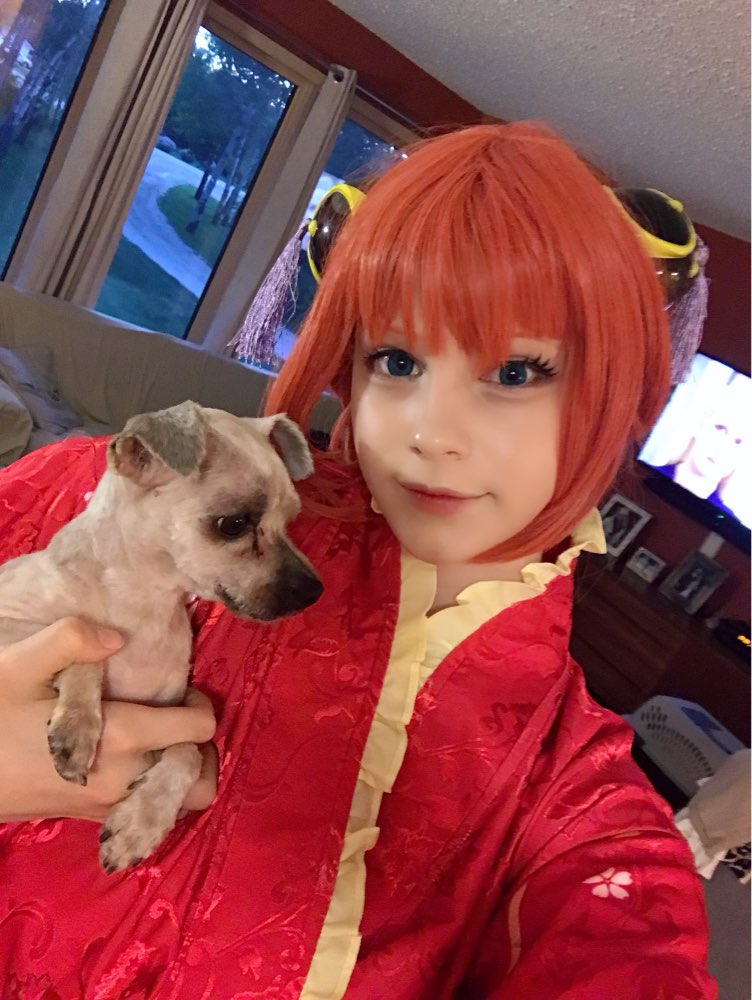 a very nice wig! The cups are really well made too. The wig is a little more red than the photo but still match kagura
