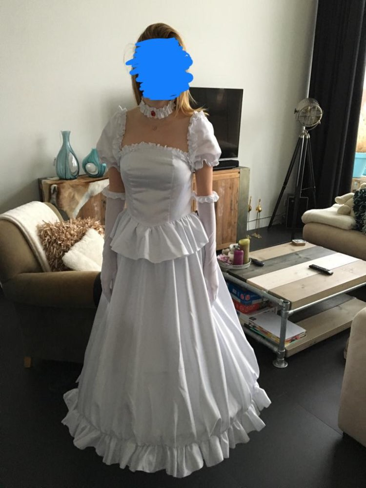 I absolutely love it! It came really fast, the seller was nice and the quality is amazing. It looks exactly like the picture. (Note! I am wearing a hoop petticoat underneath!)
